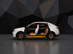 黒いポリゴン背景にパールホワイトの電動SUVのインテリアイメージの写真素材 [FYI04647126]