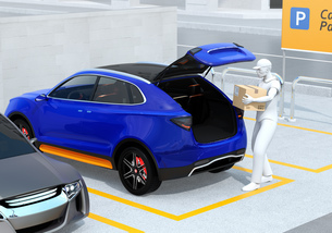 配達員が駐車場にあるクルマのトランクを開け、車内配達サービスを行う。ラストワンマイルコンセプトの写真素材 [FYI04647183]