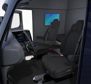 電動トラックのインテリアイメージ。運転席の後ろ側にベッドと壁掛けモニターが備えているの写真素材 [FYI04647281]