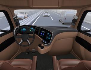 高速道路に走行している自動運転トラックの運手席からみるイメージ。の写真素材 [FYI04647283]
