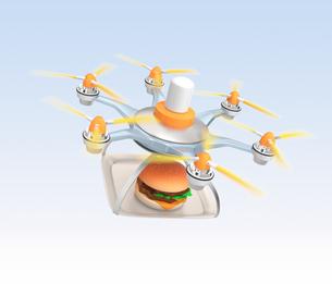 ドローンによるハンバーガー外食の配送の写真素材 [FYI04647404]