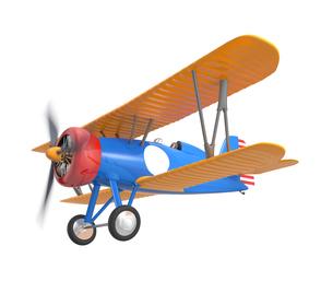 空を飛ぶレトロ複葉機の写真素材 [FYI04647520]