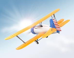 黄色複葉機が太陽に向けて飛ぶの写真素材 [FYI04647521]
