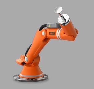 オレンジ色のロボットアームの写真素材 [FYI04647691]