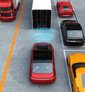 市街地に走行中のクルマが自動ブレーキをかけるコンセプトイメージの写真素材 [FYI04647772]