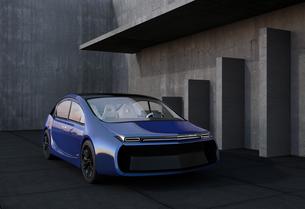 美術館外壁前にある青色電気自動車の写真素材 [FYI04647784]
