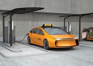 充電中のタクシーの写真素材 [FYI04648022]