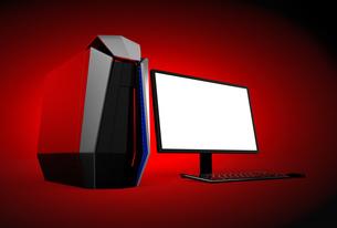 赤バックにあるゲーミングPCのイメージ。モニターにコピースペース付きの写真素材 [FYI04648058]