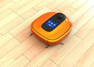 メタリックオレンジカラーのお掃除ロボットの写真素材 [FYI04648226]
