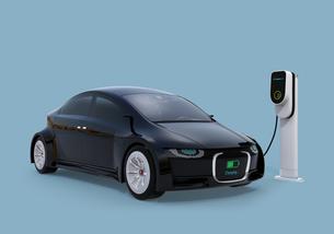 充電中の電気自動車のフロント部に充電状態が表示されている。車と人のコミュニケーションのコンセプトの写真素材 [FYI04648427]