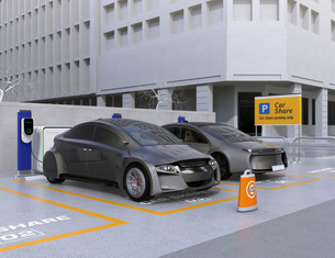 カーシェア専用駐車場に駐車している無人運転電気自動車。カーシェアリングのコンセプトの写真素材 [FYI04648449]