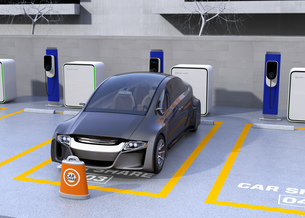 カーシェア専用駐車場に駐車している無人運転電気自動車。カーシェアリングのコンセプトの写真素材 [FYI04648453]