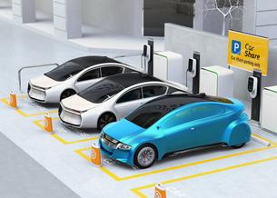 カーシェア専用駐車場に駐車している無人運転電気自動車。カーシェアリングのコンセプトの写真素材 [FYI04648464]