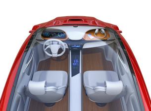 電気自動車のダッシュボードにワイヤレス充電しているスマホとヘッドフォンのイメージの写真素材 [FYI04648545]