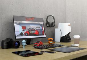 机にあるモニター、3Dスキャナー、板タブ、スマホと一眼レフ。プロダクトデザイナーのワークスペースの写真素材 [FYI04648611]