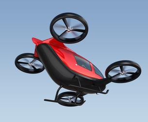 空を飛ぶ自動運転ドローンタクシーの写真素材 [FYI04648625]