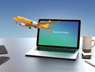 ノートパソコンから飛び立つ飛行機のイメージ。オンラインチェックインサービスのコンセプトの写真素材 [FYI04648648]