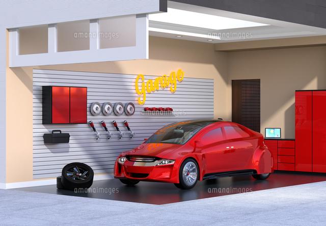 赤色電気自動車が止まっているガレージのイメージの写真素材 [FYI04648691]
