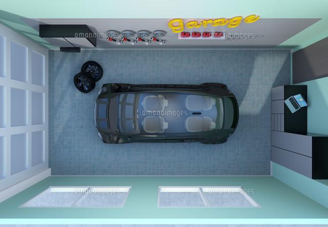 黒色電気自動車が止まっているガレージの鳥瞰イメージの写真素材 [FYI04648693]