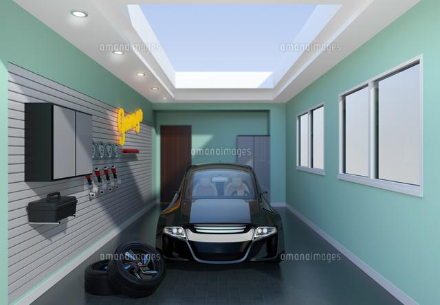 黒色電気自動車が止まっているガレージの正面イメージの写真素材 [FYI04648703]