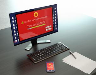 ランサムウェア被害を受けたデスクトップPC、スマートフォン画面のイメージの写真素材 [FYI04648761]