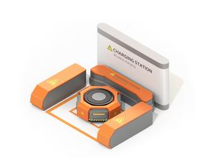 ワイヤレス充電スタンドに充電しているオレンジ色の自動運搬ロボットの写真素材 [FYI04648793]