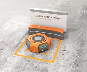 ワイヤレス充電スタンドに充電しているオレンジ色の自動運搬ロボットの写真素材 [FYI04648796]