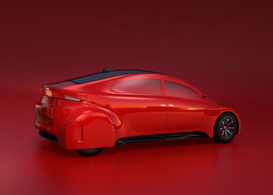 赤い背景にある赤いセダンのイメージ。オリジナルデザインの写真素材 [FYI04648883]