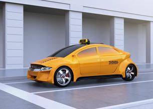 停止車線に止まっている黄色いタクシーのイメージの写真素材 [FYI04648959]
