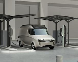充電スタンドに充電している電気自動車イメージの写真素材 [FYI04648975]
