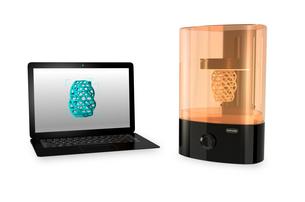 光造形式3Dプリンタとノートパソコン。パソコン画面に3Dモデルが表示されている。の写真素材 [FYI04665790]