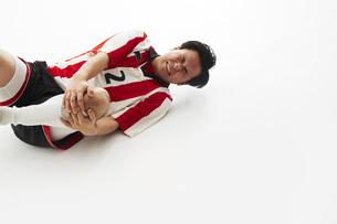 足を負傷するサッカー選手の写真素材 [FYI04666785]
