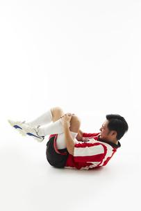 足を負傷するサッカー選手の写真素材 [FYI04666786]