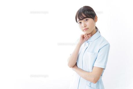 看護師_悩み事_ひらめきの写真素材 [FYI04702345]