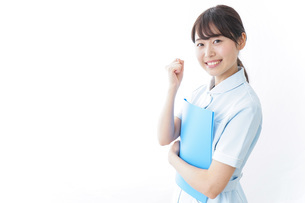 ガッツポーズをする看護師の写真素材 [FYI04702380]