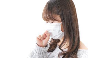 風邪をひいた女性の写真素材 [FYI04704022]
