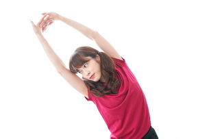 準備運動をする女性の写真素材 [FYI04706494]