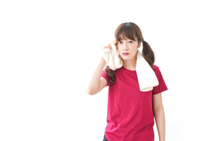 汗を拭く女性の写真素材 [FYI04706612]