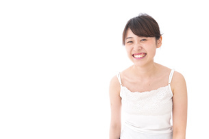 笑顔で誘う女性の写真素材 [FYI04707970]