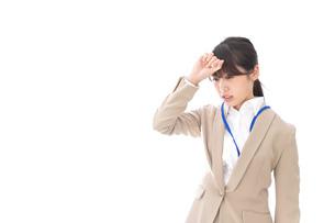 ビジネスウーマン・頭痛の写真素材 [FYI04709350]