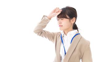 ビジネスウーマン・頭痛の写真素材 [FYI04709358]
