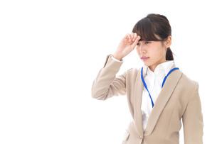 ビジネスウーマン・頭痛の写真素材 [FYI04709359]