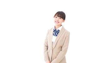 制服を着た笑顔の学生の写真素材 [FYI04709424]
