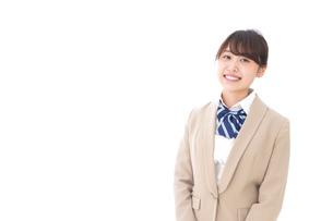制服を着た笑顔の学生の写真素材 [FYI04709426]