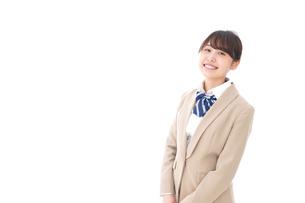 制服を着た笑顔の学生の写真素材 [FYI04709429]