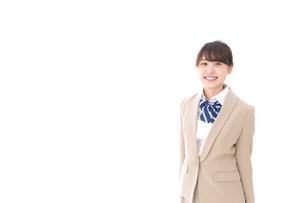 制服を着た笑顔の学生の写真素材 [FYI04709431]