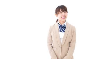 制服を着た笑顔の学生の写真素材 [FYI04709433]