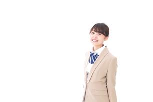 制服を着た笑顔の学生の写真素材 [FYI04709434]