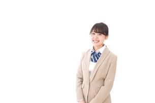 制服を着た笑顔の学生の写真素材 [FYI04709435]