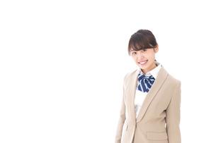 制服を着た笑顔の学生の写真素材 [FYI04709436]